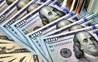 Spread of 100 dollar bills