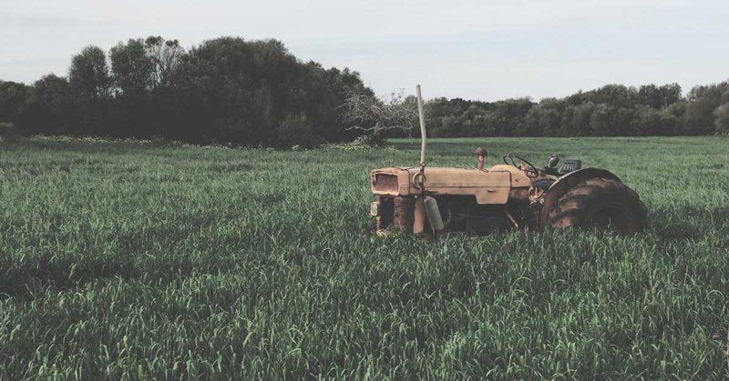 broken down tractor in a field