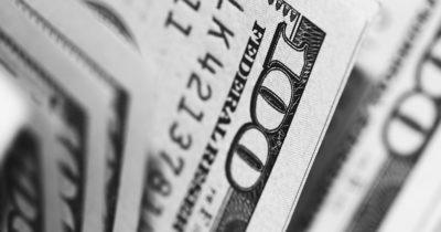 black and white image of 100 dollar bills